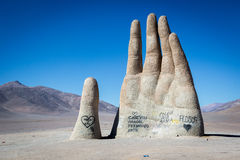 Big hand monument in the middle of the desert in northern Chile. Royalty Free Stock Image