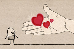 Big Hand - offering hearts Royalty Free Stock Images