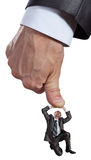 Big hand pushing businessman Stock Photo
