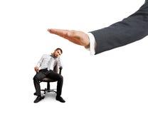 Big hand ready to slap lazy businessman Royalty Free Stock Image
