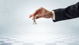 Big hand taking his next step on chess game royalty free stock photo