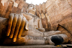 Big hands of praying Buddha inside small temple, built in 13th century Royalty Free Stock Photos