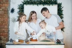 Big happy family baking with little daughters. On a kitchen Stock Image