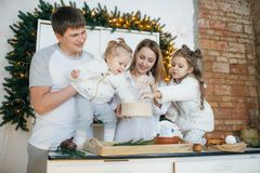 Big happy family baking with little daughters. On a kitchen Stock Images