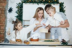 Big happy family baking with little daughters. On a kitchen Royalty Free Stock Photos