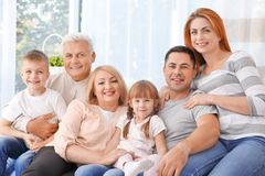Big happy family. On couch royalty free stock image