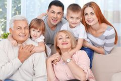 Big happy family on couch. At home Stock Images