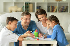 Big happy family drawing together Royalty Free Stock Image