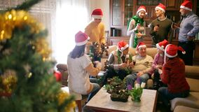 Big happy family gathered in parental home for traditional Christmas celebration, posing together on couch