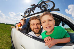 Big happy family going on holiday trip in summer. Big happy family, young father and three age-diverse boys, going on holiday trip by car in summertime Stock Images