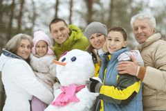 Family in winter park. Big happy family having fun in winter park covered with snow Royalty Free Stock Image