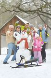Family in winter park. Big happy family having fun in winter park covered with snow Royalty Free Stock Photo