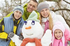 Family in winter park. Big happy family having fun in winter park covered with snow Stock Photo
