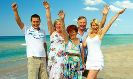 Big happy family waving hands on sea beach Stock Image