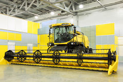 Big harvester are in room at exhibition Royalty Free Stock Photo