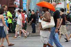 Big Hat. A volunteer for SXSW and his big hat take a walk along 6th street in Austin, TX Stock Images