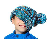 Big hat. Seven years boy with stylish hat on his face isolated on white background Royalty Free Stock Image