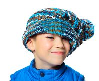 Big hat. Seven years boy with stylish hat on his face isolated on white background Royalty Free Stock Images