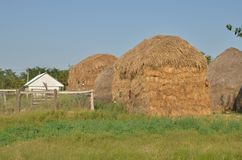 Big haystacks. Formed of many stacked hay bales. Countryside summer scene royalty free stock image