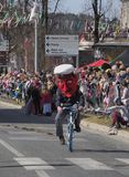 Big head costume police bike stock photography