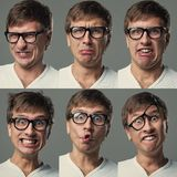 Big head guy makes crazy face emotions Royalty Free Stock Photography