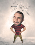 Big head person with drawn hammers Stock Image