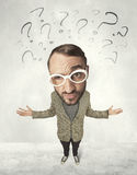 Big head person with question marks Royalty Free Stock Images