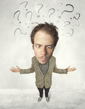 Big head person with question marks Stock Images