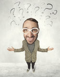 Big head person with question marks. Funny person with big head and drawn question marks over it Stock Image
