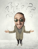 Big head person with question marks Royalty Free Stock Photos