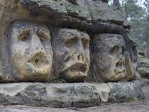 Big head sculpted in 1846 by Vaclav Levy to the sand stone rock. In Zelizy, czech republic Royalty Free Stock Image