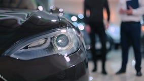 Big headlamp of electric car stock video