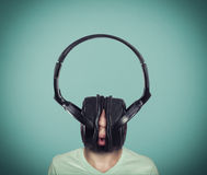 The big headphones. Man listening music on huge headphones Stock Photos
