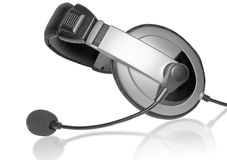 Big Headset with a microphone. On plate glass. Isolated stock photography