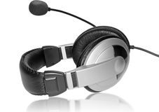Big Headset with a microphone. On plate glass Stock Image