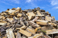 Big heap of chopped tree trunks for burning wood Royalty Free Stock Photo