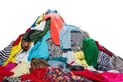 Big heap of colorful clothes. Isolated on white stock image