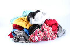 Big heap of colorful clothes isolated on white background Royalty Free Stock Photography