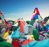 Big heap of colorful clothes. On sky background royalty free stock image