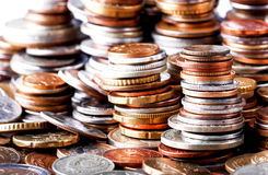Big heap of columns of different coins on white background. Royalty Free Stock Photo