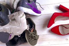 Big heap of different sports shoes. Set of sneakers Royalty Free Stock Photos
