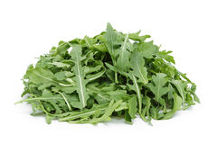 Big heap of fresh arugula. Isolated on white royalty free stock photography