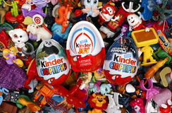Big heap of Kinder Surprise toys and eggs. Royalty Free Stock Photo