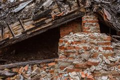 Heap of the red bricks which have stayed at home after destroyed stock images
