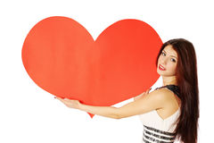 Big heart. Woman holding a heart on Valentine's Day Royalty Free Stock Photos