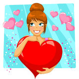 Big heart. Pretty girl holding a big heart Royalty Free Stock Photography