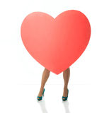 Big heart female legs Royalty Free Stock Photo