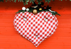 Big heart hanging on red Royalty Free Stock Photography