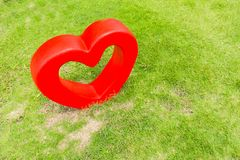 Big heart made from cement for decorative garden. Stock Photo