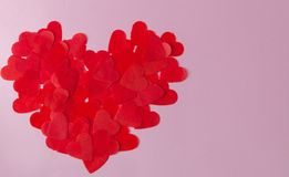 Big heart made from little paper hearts on pink background. Valentine s Day, love symbol.  stock photography